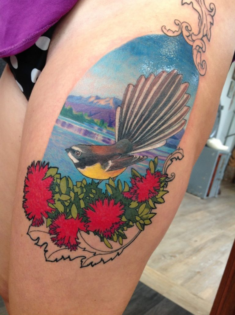 coloured fantail flower thigh tattoo