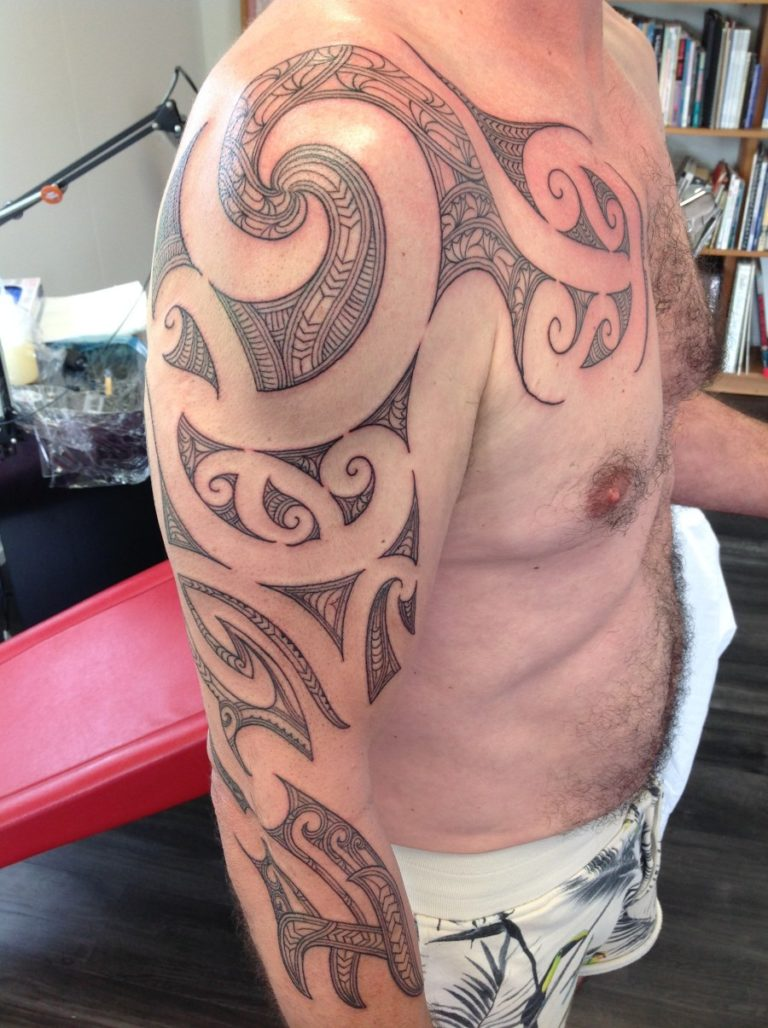 maori shoulder and chest tattoo